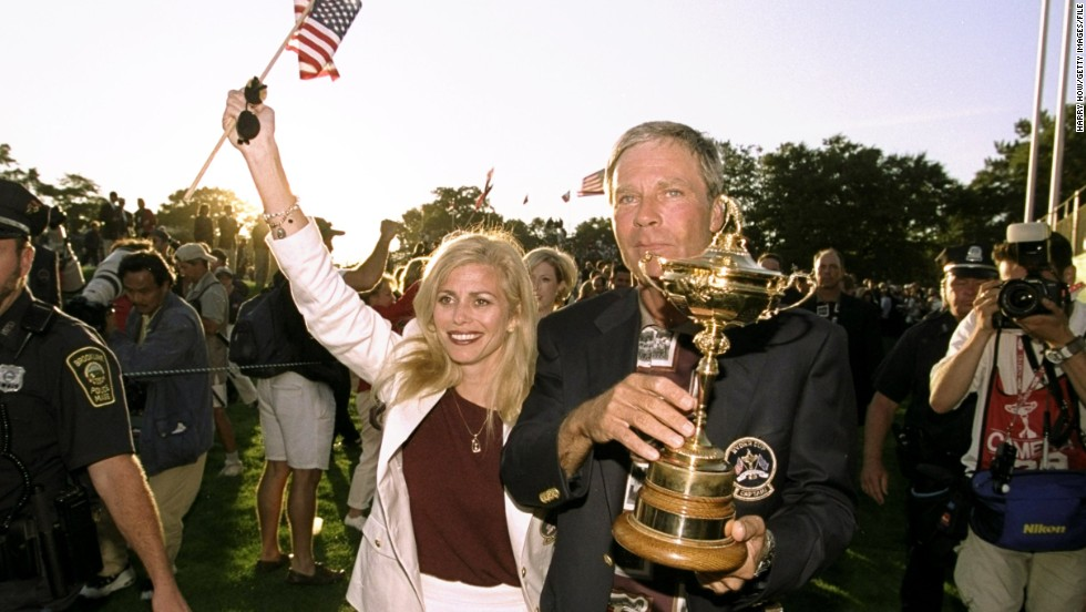 Ben Crenshaw the USA captain, celebrates with his wife after the USA win the 33rd Ryder Cup in 1999, played at Brookline Country Club in Boston, Massachusetts.