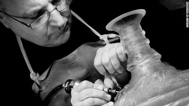 A Lalique master craftsman working on The Macallan 64 year old, auctioned for $460,000