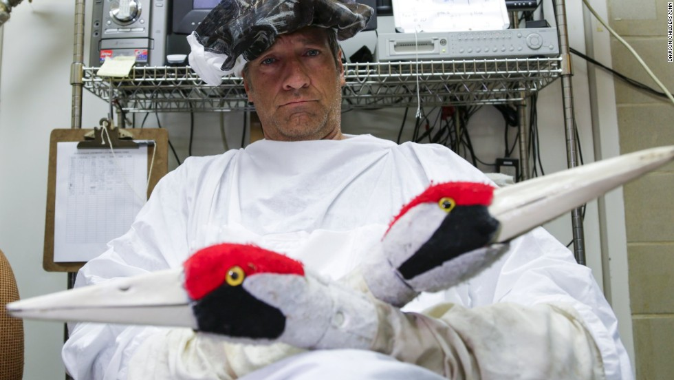 Rowe traveled to a Maryland facility that's helping to replenish the endangered whooping crane population. Armed with crane puppets and special clothing, he joined the workers who interact with the birds.