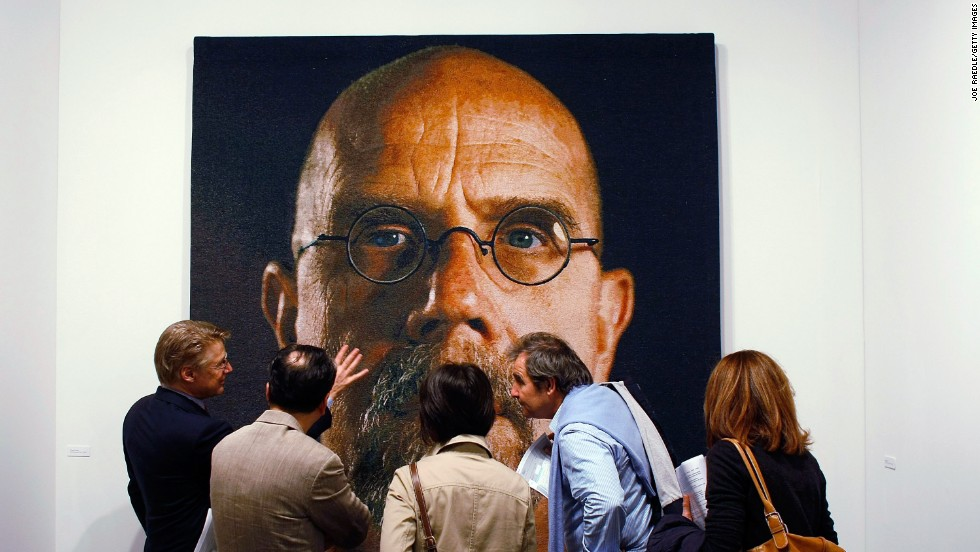 "<a href=""http://www.pacegallery.com/artists/80/chuck-close"" target=""_blank"">Chuck Close</a> is the granddaddy of hyper-realism, starting out creating photo-real images -- like this<a href=""http://www.walkerart.org/collections/artworks/big-self-portrait"" target=""_blank""> famous self portrait from 1967</a> -- in the days when art theorists were claiming that portraiture was dead."