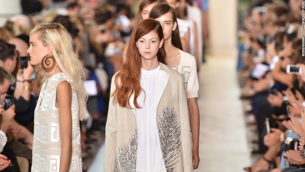 "Tory Burch embroidered crystals onto a linen coat for this <a href=""http://www.cnn.com/2014/02/17/living/natalie-westling-redhead-model-fashion-week/"">model's</a> look during her show on September 9."