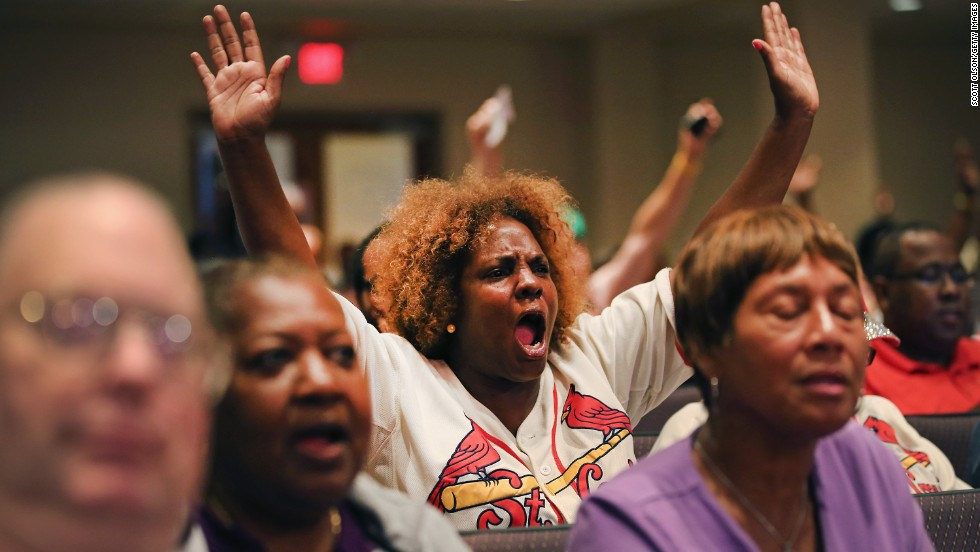 Attendees shout during the meeting. The meeting was the first for the City Council since the fatal shooting of Michael Brown by a city police officer.