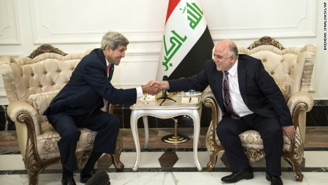 U.S. Secretary of State John Kerry, left, shakes hands with new Iraqi Prime Minister Haider al-Abadi after a meeting in Baghdad, Iraq, Wednesday,  Sept. 10, 2014. Kerry is traveling to the mideast this week to discuss ways to bolster the stability of the new Iraqi government and combat the Islamic State militant group that has taken over large swaths of Iraq and Syria. (AP Photo/Brendan Smialowski, Pool)