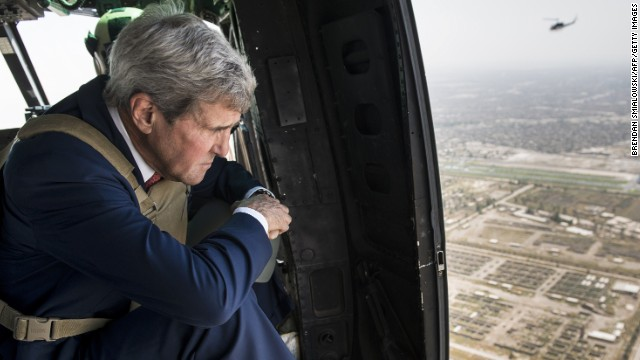 Caption:US Secretary of State John Kerry looks out over Baghdad from a helicopter on September 10, 2014. Kerry flew into Iraq today for talks with its new leaders on their role in a long-awaited new strategy against Islamic State jihadists to be unveiled by President Barack Obama. AFP PHOTO/POOL/BRENDAN SMIALOWSKI (Photo credit should read BRENDAN SMIALOWSKI/AFP/Getty Images)
