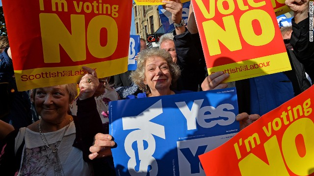 "GLASGOW, SCOTLAND - SEPTEMBER 10: ""Yes"" and ""No"" voters protest as John Prescott and Alistair Darling join the Scottish Labour Battle Bus on Rutherglen main street on September 10, 2014 in Glasgow, Scotland. The three UK party leaders are all campaigning in Scotland today showing their support for a ""No"" vote in the independence referendum. (Photo by Mark Runnacles/Getty Images)"