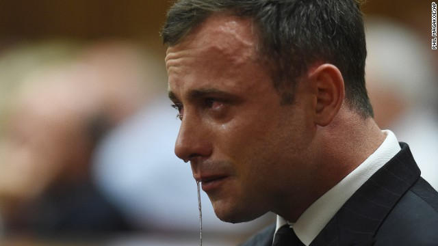 Oscar Pistorius cries in the dock in Pretoria, South Africa, Thursday Sept. 11, 2014 as Judge Thokozile Masipa reads notes as she delivers her verdict in Pistorius' murder trial. The South African judge in Oscar Pistorius' murder trial said Thursday that prosecutors have not proved beyond a reasonable doubt that the double-amputee Olympic athlete is guilty of premeditated murder.  (AP Photo/Phil Magakoe, Pool)