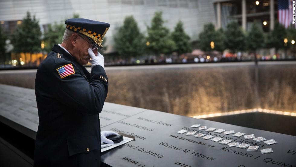 Sam Pulia, the mayor of Westchester, Illinois, and a former police officer of the same town, mourns over the name of his cousin, New York firefighter Thomas Anthony Casoria, who was killed on 9/11.