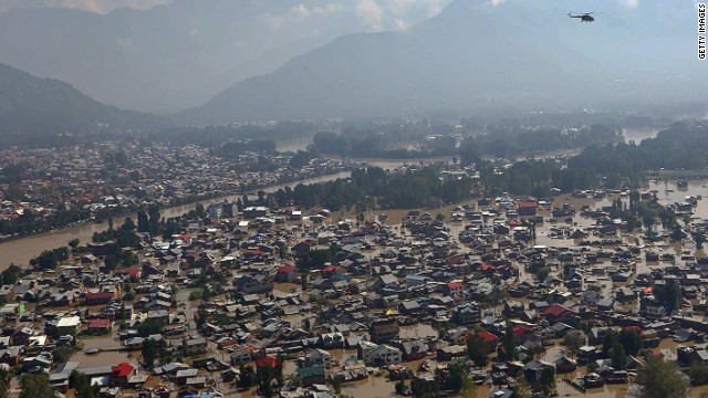 SRINAGAR, KASHMIR, INDIA - SEPTEMBER 10: In this handout photo provided by the Indian Defence Ministry, A view of residential houses submerged in flooded waters on September 10, 2014 in Srinagar, the summer capital of Indian administered Kashmir, India. More than a million people have been cut off from clean water and thousands of buildings submerged in flood water have been left uninhabitable. The floods in the Himalayan region of Kashmir are believed to be the worst in decades and have left approximately 400,000 people stranded and over 200 dead. (Photo by Yawar Nazir/Getty Images)