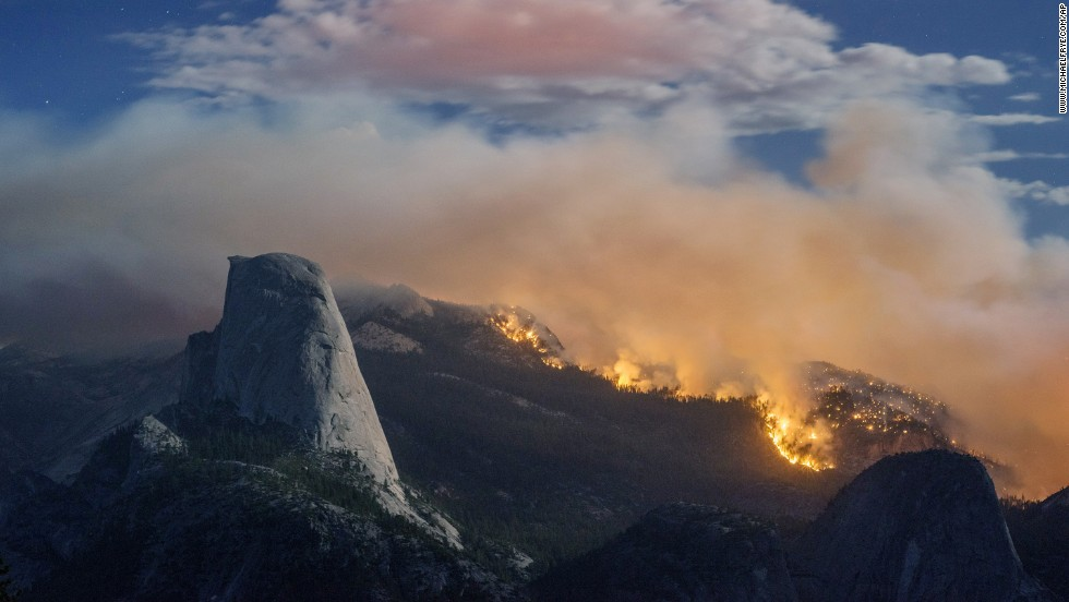 "A wildfire burns next to Half Dome in California's Yosemite National Park on Sunday, September 7. Because of the fire, <a href=""http://www.cnn.com/2014/09/10/us/yosemite-national-park-wildfire/"">the park had to close the famous rock formation.</a> The rest of the park remained open."
