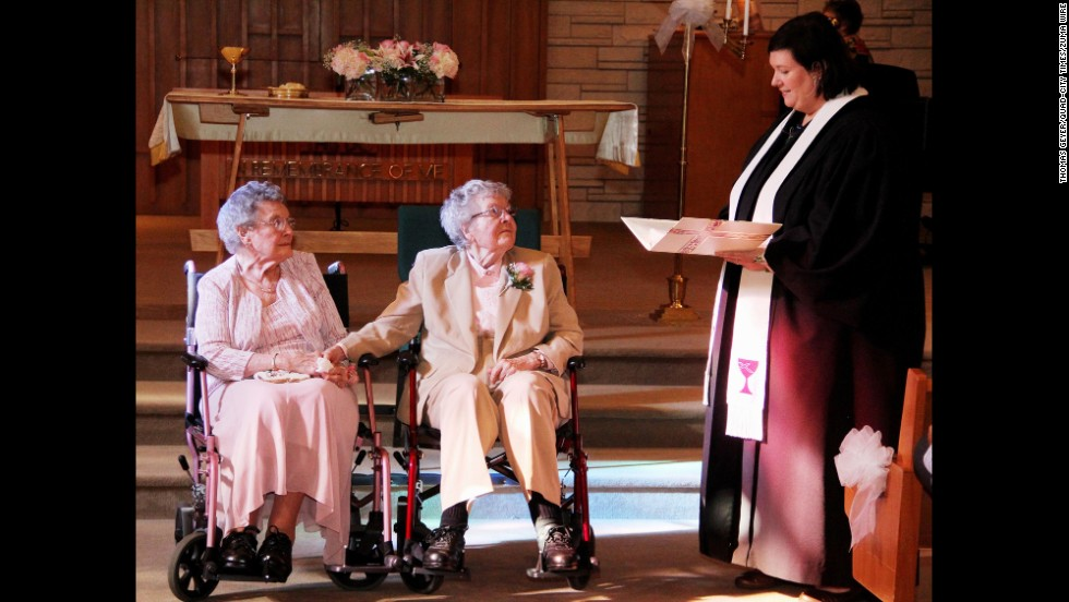 "The Rev. Linda Hunsaker presides over the wedding of 91-year-old Vivian Boyack, left, and 90-year-old Alice ""Nonie"" Dubes on Saturday, September 6, in Davenport, Iowa. The two women were married more than seven decades after beginning their relationship."