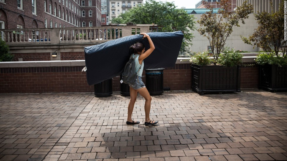 Emma Sulkowicz, a senior at Columbia University in New York, carries a mattress on campus Friday, September 5. Sulkowicz has said she is committed to carrying the mattress everywhere she goes until the university expels the student she says raped her during her sophomore year. The protest is also doubling as her senior thesis project.