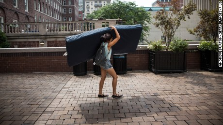 Emma Sulkowicz, a senior visual arts student at Columbia University, carries a mattress in protest of the university's lack of action after she reported being raped during her sophomore year on September 5, 2014 in New York City. Sulkowicz has said she is committed to carrying the mattress everywhere she goes until the university expels the rapist or he leaves. The protest is also doubling as her senior thesis project.
