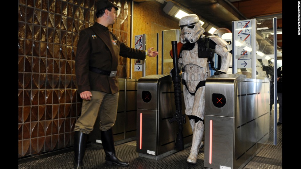 "People wearing ""Star Wars"" costumes make their way through a metro station after a Balloon's Day Parade in Brussels, Belgium, on Saturday, September 6."
