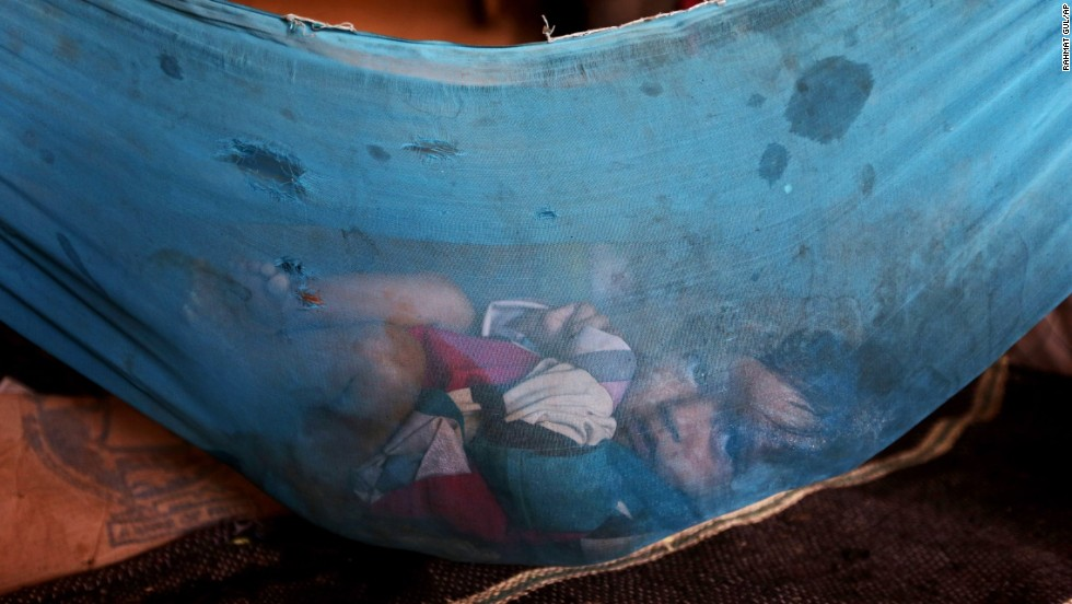A 5-month-old Afghan girl rests in a makeshift cradle inside a tent on the outskirts of Kabul, Afghanistan, on Monday, September 8.