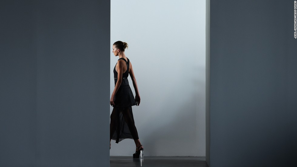 Calvin Klein layered a racerback, knit dress over a longer skirt to lengthen the model's stature for spring.