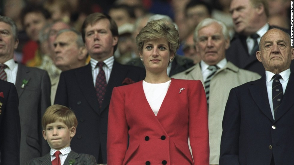 Prince Harry stands with Princess Diana for the national anthem at the Wales versus Australia match during the 1991 World Cup in Cardiff, Wales, on October 12, 1991.