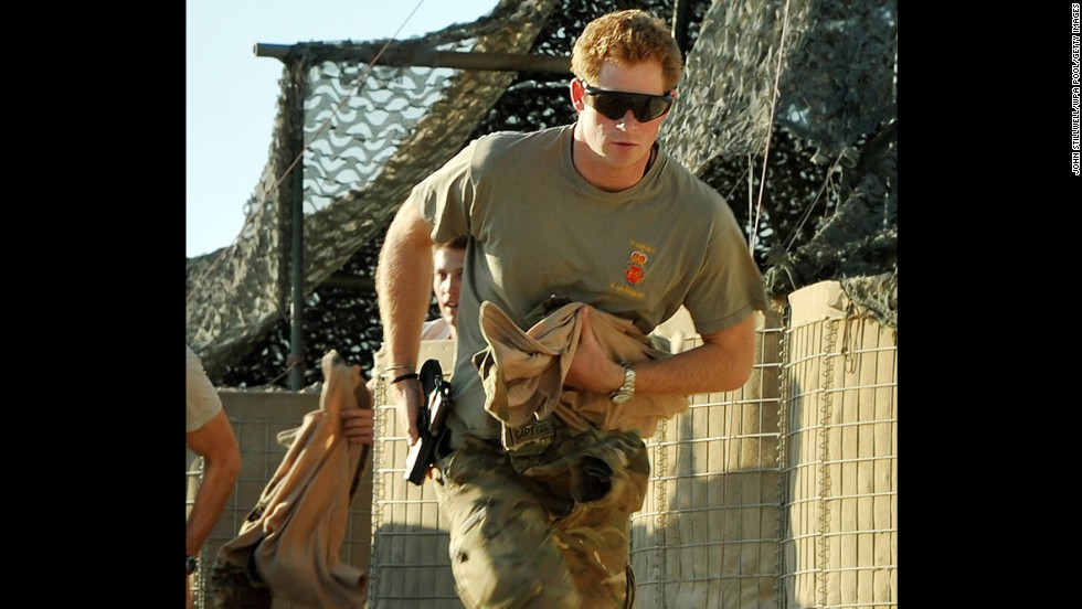 Prince Harry races out from a tent to scramble his Apache with fellow pilots during his 12-hour shift on November 3, 2012, at Camp Bastion in Afghanistan. Prince Harry served as an Apache helicopter pilot and gunner.