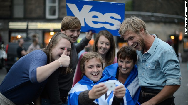 """Separatist campaign supporters take a selfie outside Usher Hall ahead of the """"A Night for Scotland"""" concert in Edinburgh, Scotland, on Sunday, September 14."""