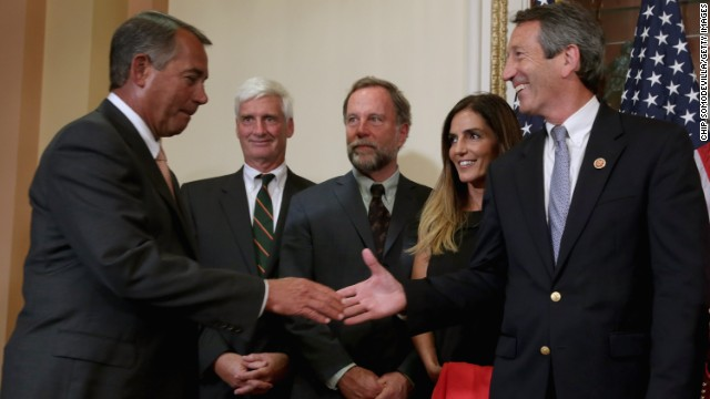 Speaker of the House John Boehner (R-OH) greets U.S. Rep. Mark Sanford (R-SC) (R), Sanford's fiance Maria Belen Chapur (2nd R) and members of Sanford's family before a ceremonial swearing-in at the U.S. Capitol May 15, 2013 in Washington, DC.