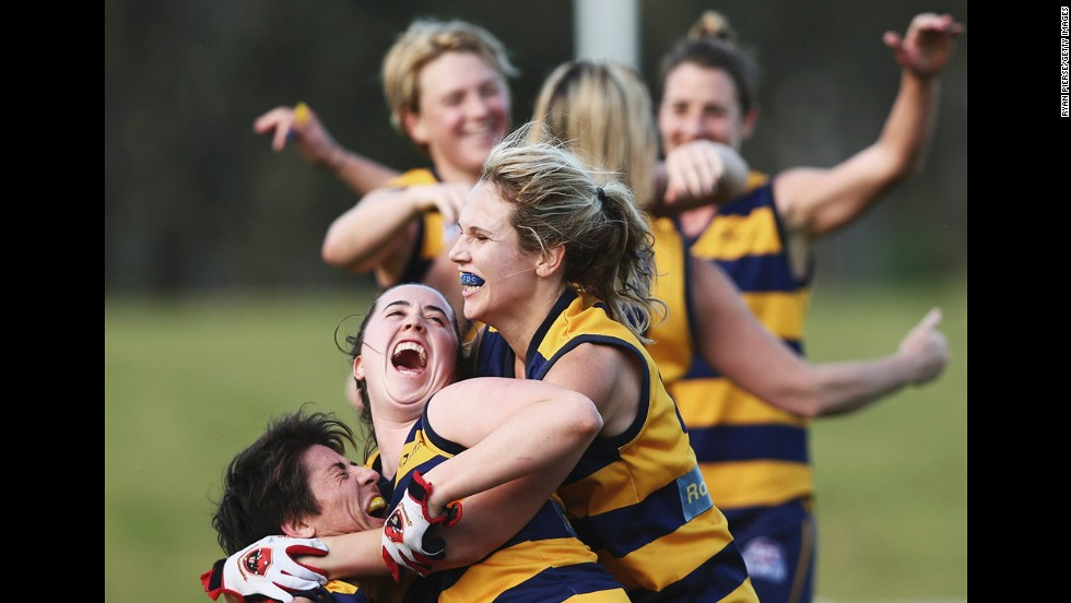 The Sydney University Bombers celebrate Saturday, September 13, after defeating the UNSW-ES Stingrays in the grand final of the Sydney Women's Australian Football League.