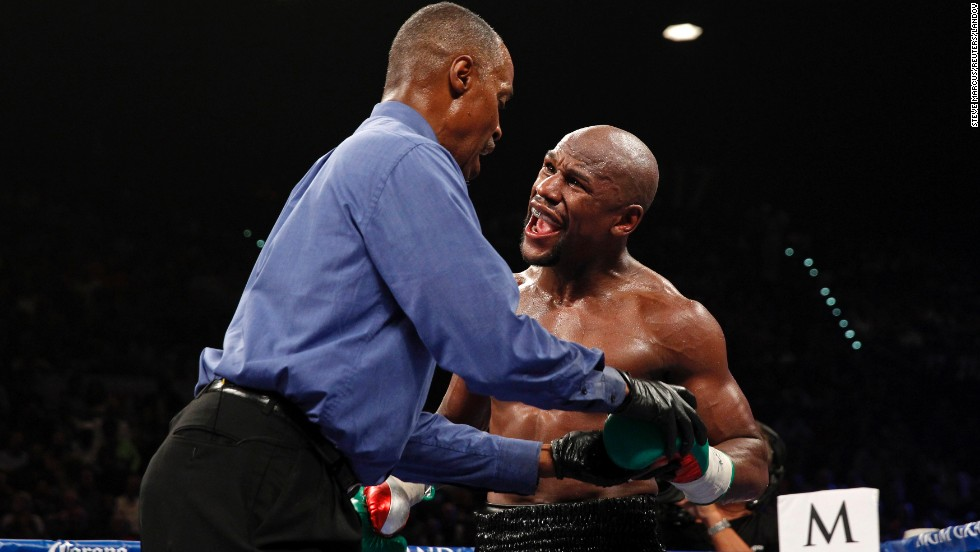 Boxer Floyd Mayweather complains to referee Kenny Bayless, saying that Marcos Maidana bit his fingers during their welterweight title fight Saturday, September 13, in Las Vegas. Mayweather, the WBA and WBC champion, would go on to win the fight by unanimous decision. Maidana denied biting Mayweather.