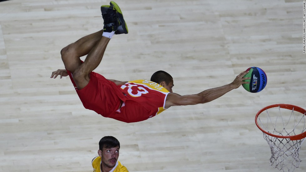 An acrobat performs at the FIBA World Cup before Serbia defeated France in a semifinal game Friday, September 12, in Madrid.