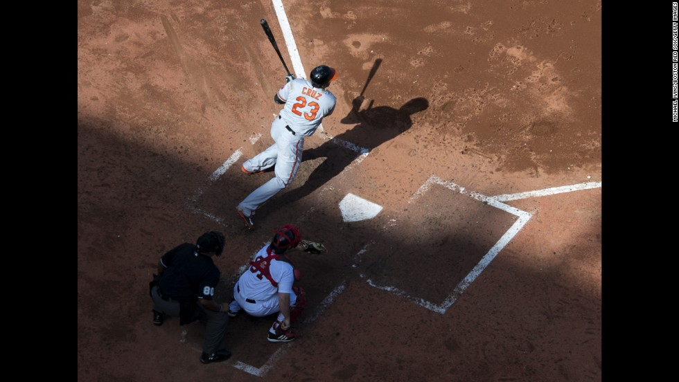 Nelson Cruz of the Baltimore Orioles doubles against the Boston Red Sox during a Major League Baseball game Wednesday, September 10, in Boston.
