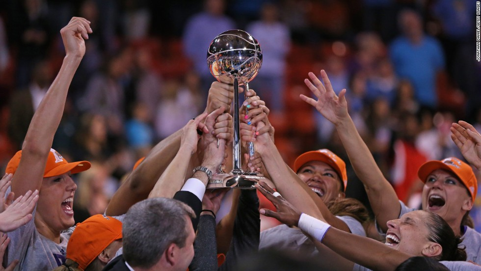 Members of the Phoenix Mercury hold the championship trophy after defeating the Chicago Sky in the WNBA Finals on Friday, September 12. It is the third WNBA title for Phoenix, which also won the league in 2007 and 2009.