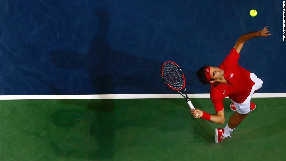 Roger Federer of Switzerland serves to Simone Bolelli of Italy during a Davis Cup match played Friday, September 12, in Geneva, Switzerland. Federer won the singles match in straight sets, and Switzerland would go on to advance to the Davis Cup final against France.
