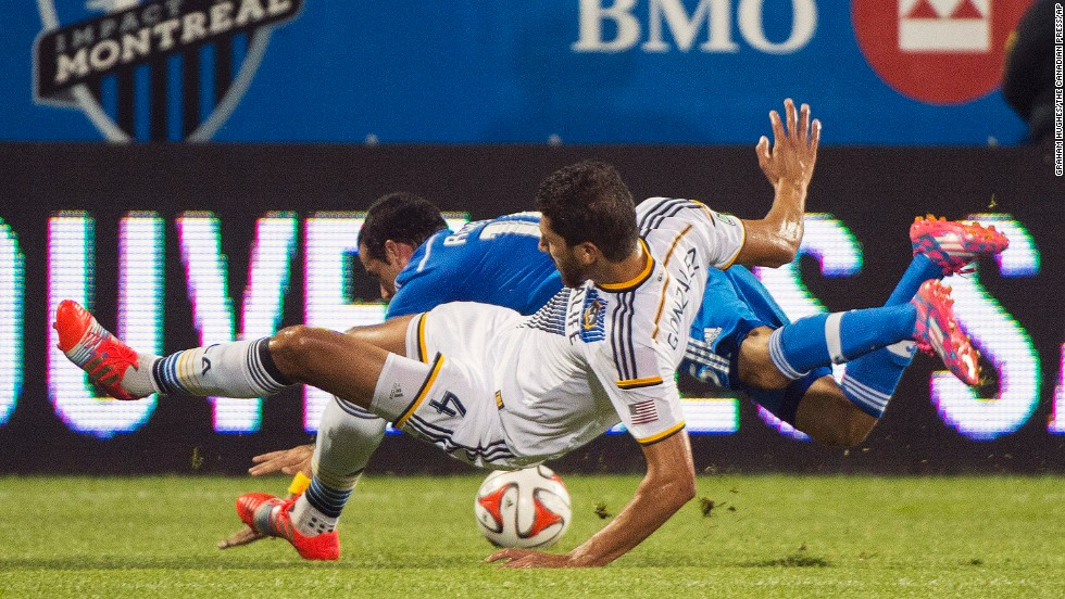 Los Angeles' Omar Gonzalez, front, collides with Montreal's Andres Romero during a Major League Soccer match Wednesday, September 10, in Montreal. The two teams played to a 2-2 draw.
