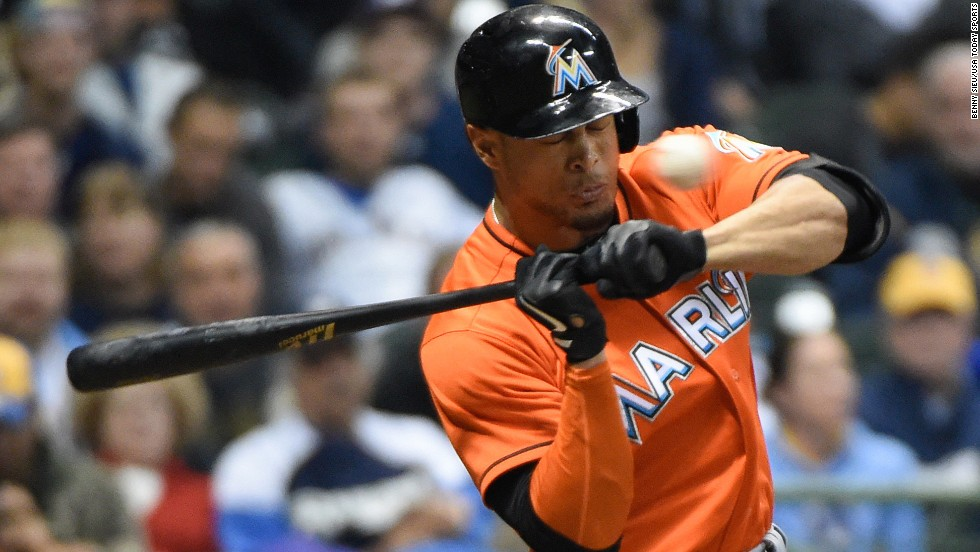 "Miami Marlins right fielder Giancarlo Stanton is <a href=""http://www.cnn.com/2014/09/12/us/marlins-stanton-injured/"">hit in the face by a pitch</a> Thursday, September 11, in Milwaukee. The impact shattered bones and caused tooth damage, according to the team, and Marlins manager Mike Redmond said Stanton would be out for the rest of the year. <a href=""http://www.cnn.com/2014/09/09/worldsport/gallery/what-a-shot-0909/index.html"">See 40 amazing sports photos from last week</a>"
