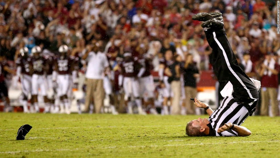 Russ Pulley, a college football official, falls down on a play during the Georgia-South Carolina game Saturday, September 13, in Columbia, South Carolina.