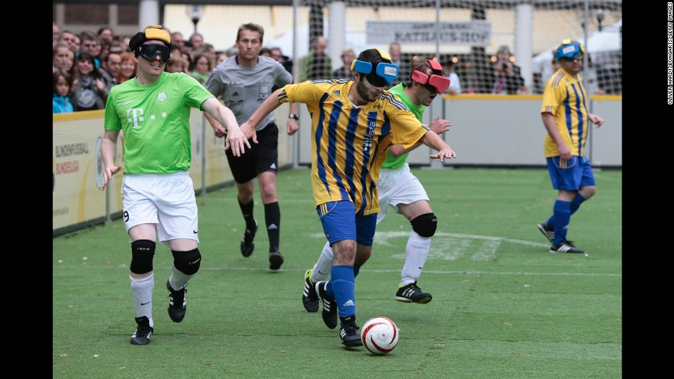 Players in Germany's blind soccer league compete in the final match of the season Saturday, September 13, in Lubeck, Germany.