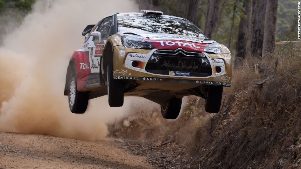 A Citroen car driven by Kris Meeke catches some air during a race at the World Rally Championship of Australia on Friday, September 12.