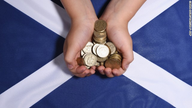In this photo illustration, pound coins are placed on a Saltire flag on August 20 in Glasgow,Scotland.