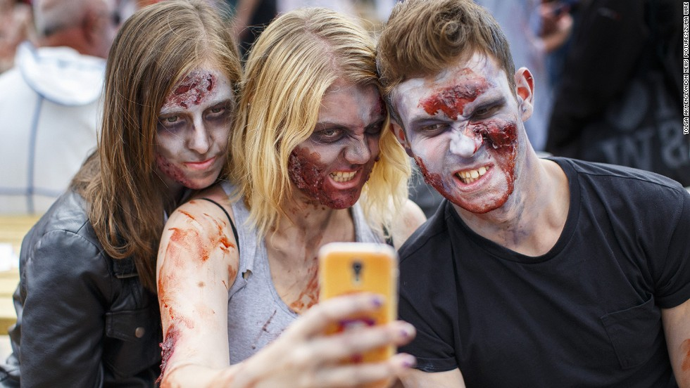 People dressed as zombies take part in Zombie Walk Birmingham, which raised money for a children's hospital Saturday, September 13, in Birmingham, England.