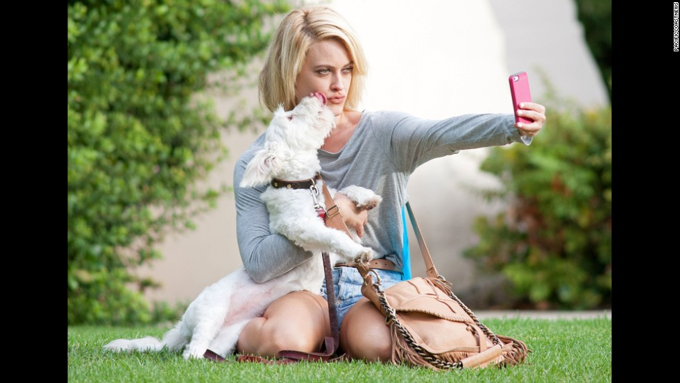 "Professional dancer Peta Murgatroyd snaps a selfie with a playful puppy in Los Angeles before heading to rehearsal for the television show ""Dancing with the Stars"" on Wednesday, September 10."