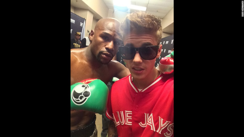 "Boxing champion Floyd Mayweather poses for a selfie with pop star Justin Bieber in Las Vegas on Saturday, September 13. ""My family @justinbieber is always supporting me and I appreciate him,"" <a href=""https://shots.com/floydmayweather/p/ljd19da1"" target=""_blank"">Mayweather wrote.</a>"