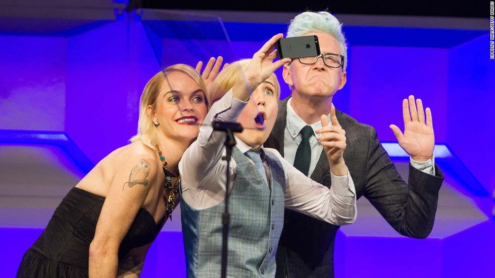 From left, actress Taryn Manning, comedian Hannah Hart and YouTube personality Tyler Oakley take a selfie together at the GLAAD Gala in San Francisco on Saturday, September 13.