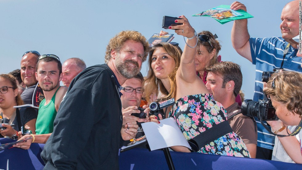 Actor Will Ferrell poses with a fan Wednesday, September 10, at the Deauville American Film Festival in Deauville, France.