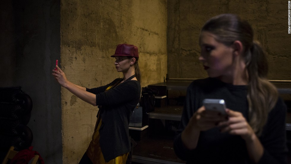 "A model takes a selfie backstage before the Fashion Marathon in Prague, Czech Republic, on Friday, September 12. The Fashion Marathon included a catwalk nearly 2 miles long that ran through Prague's city center. <a href=""http://www.cnn.com/2014/09/10/world/gallery/look-at-me-0910/index.html"">See 24 selfies from last week</a>"