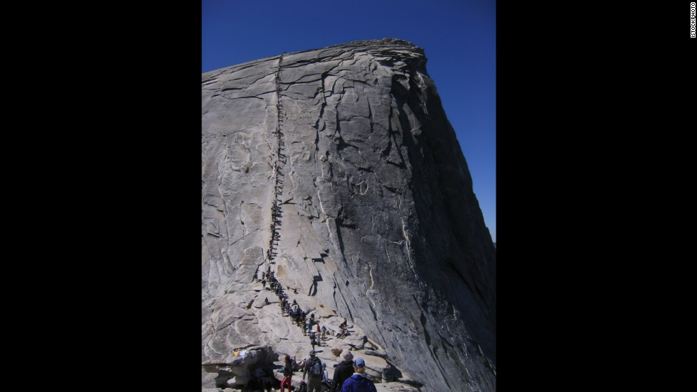 Yosemite's Half Dome in California has a stunning view--if you can get the permit and the strength to climb up the rock face along a cable ladder for more than 400 vertical feet.