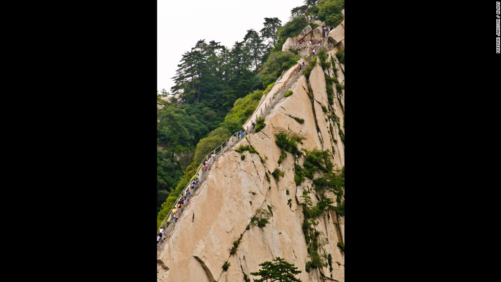 There's no official step count of the Mount Huashan Heavenly Stairs carved into the side of a Taoist mountain in China. But you'll lose count quickly by the end, where you have to walk a three-plank-wide walkway with only a chain to hold, flush against the flat rock wall. Tea awaits you at the top.