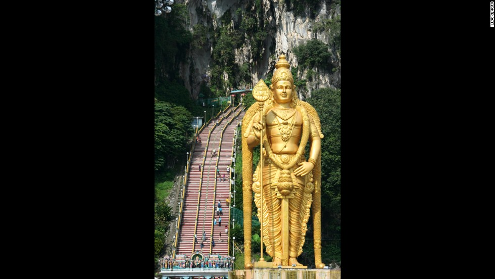 The highlight of at the Batu Caves of Malaysia is climbing the 272 steps leading 330 feet up the rock to the main Temple Cave--and making it past the macaque monkeys who might steal snacks and other things out of your bag.