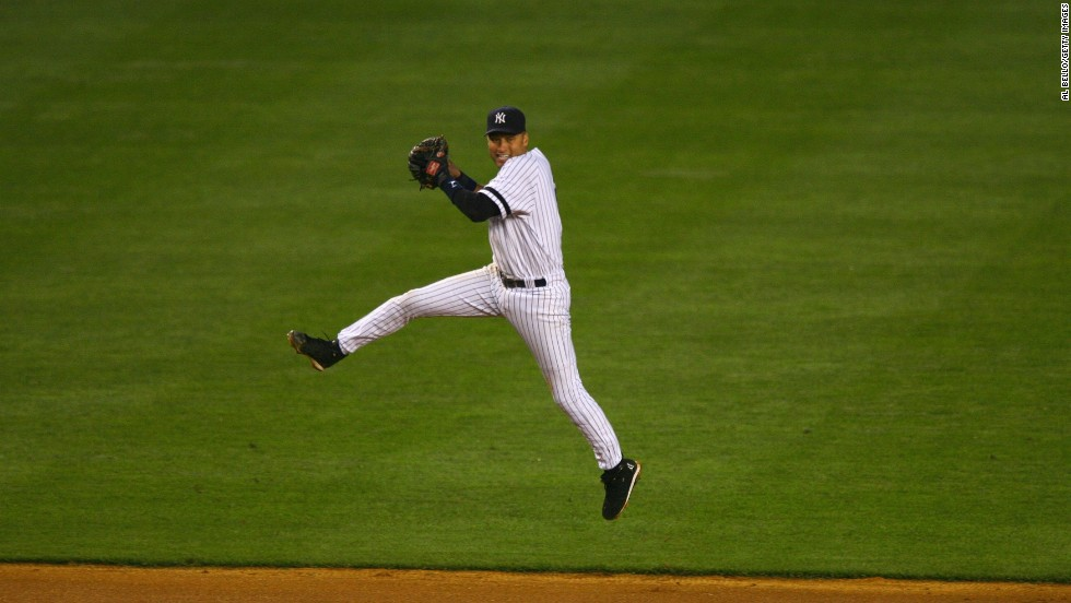Jeter jumps into the air before throwing the ball to first base in May 2007.