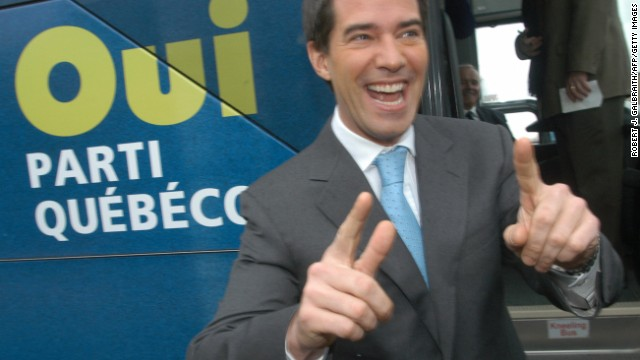 Then-leader of the separatist Parti Quebecois, Andre Boisclair boards his campaign bus after voting in 2007 as Quebec's voters decide on a new government.