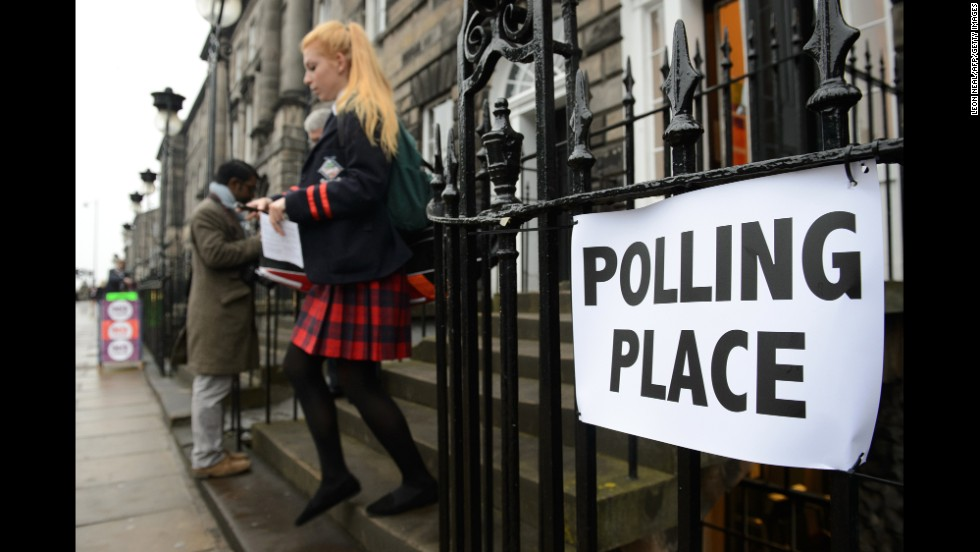 A young voter leaves a polling station September 18 in Edinburgh.
