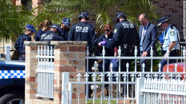 "Forensic experts collect evidence from a house in the Guildford area of Sydney on September 18, 2014. Australia's largest ever counter-terrorism raids detained 15 people and disrupted plans to ""commit violent acts"", including against random members of the public that reportedly involved a beheading on camera. AFP PHOTO / Saeed Khan        (Photo credit should read SAEED KHAN/AFP/Getty Images)"