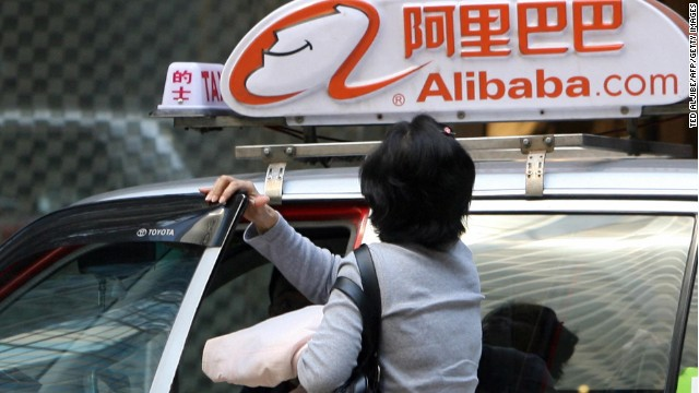 A passenger disembarks from a taxi painted with Alibaba logos, in Hong Kong, 04 November 2007. After weeks of hype and with demand exceeding the share allocation more than 150-fold, China's largest-ever Internet IPO will finally list 06 November, illustrating the insatiable demand for Chinese equities. Alibaba.com, the online business-to-business marketplace, will be the biggest Internet initial public offering since Google in 2004 when it appears on the Hong Kong market. AFP PHOTO/Ted ALJIBE (Photo credit should read TED ALJIBE/AFP/Getty Images)
