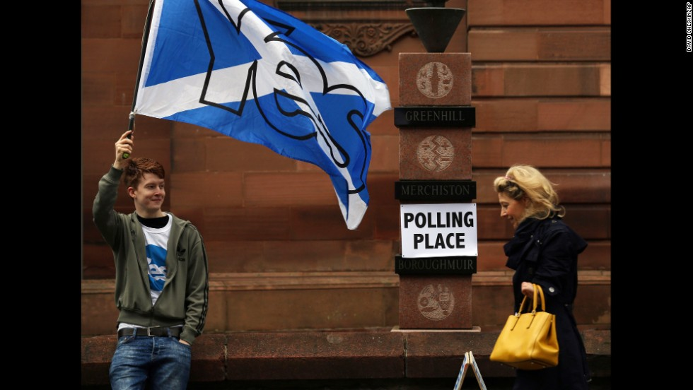 A voter arrives at a polling place September 18 in Edinburgh.
